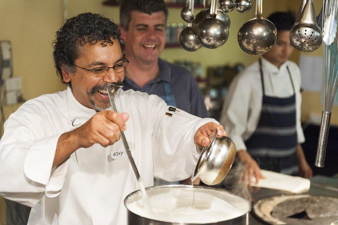 Environmental portrait of Chef Ajoy Joshi making paneer