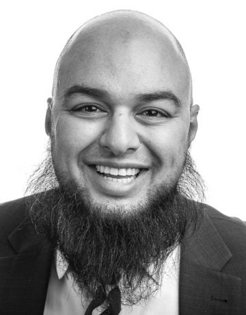corporate portrait of laughing bearded executive