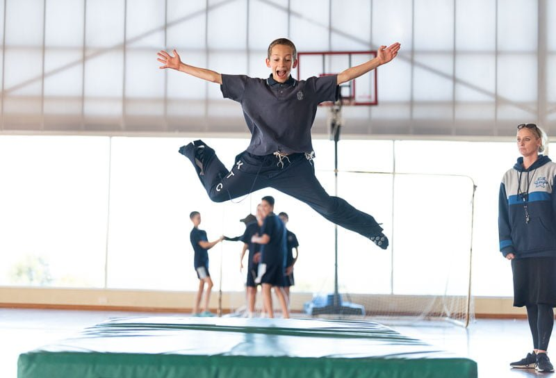 boy jumping during PE at school