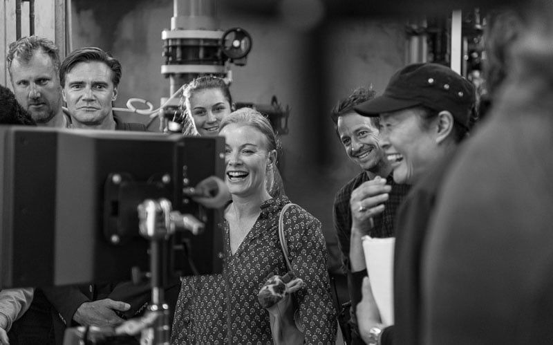 Actress laughing at takes on film set at Taronga Zoo