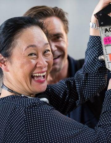 Clara Chong film director with clapboard