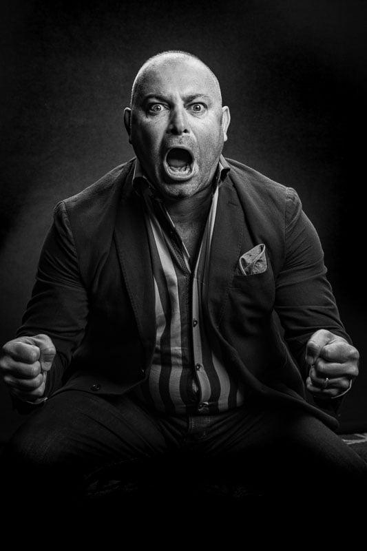 edgy film noir portrait of man shouting