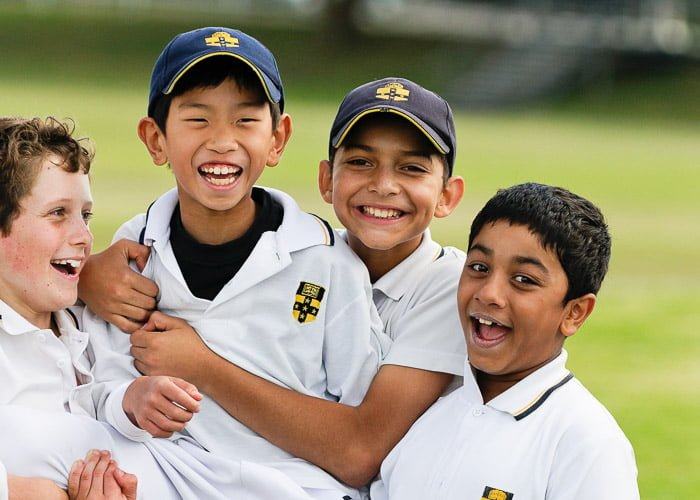 four boys celebrate a win at cricket