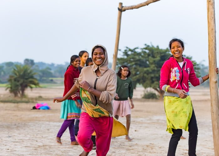 three teenage school girls in India during sports day